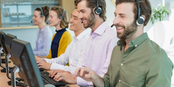 customer-service-executives-working-in-call-center-e1622445966555